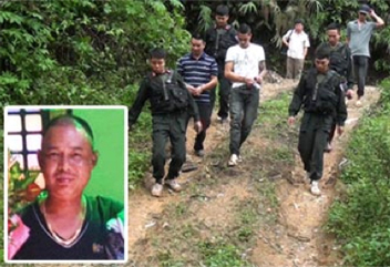 "Members of a smuggling gang led by ""Steel-face"" Dung (inset) are arrested. CREDIT: ©  Cong An Nhan Dan."