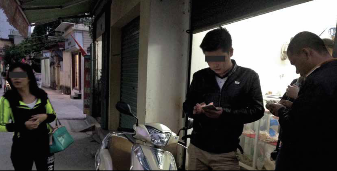 Chinese traders send messages on their smartphones to buyers in mainland China in the evenings to agree upon final prices for ivory items. Photo: Lucy Vigne